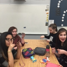 Members of the Jerome Justice League at St. Jerome school in Regina making friendship bracelets.